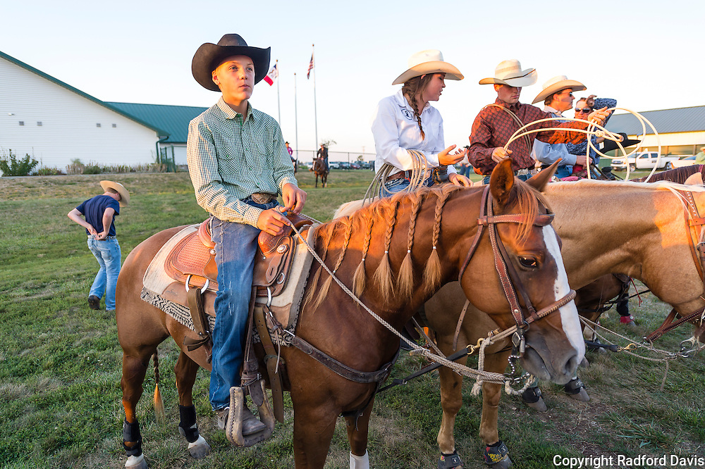 Dexter sits atop his horse, Little Bit, talking with friends and watching the goings-on. Dexter has been doing rodeo since he was 8 years old. When asked why he does it, he replied that he liked horses and working with them.