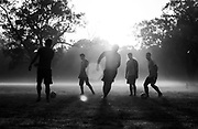 2nd October 2015, New Delhi, India. Men play football near India gate in the early morning in Delhi, India on the 2nd October 2015<br /> <br /> PHOTOGRAPH BY AND COPYRIGHT OF SIMON DE TREY-WHITE a photographer in Delhi<br /> <br /> + 91 98103 99809<br /> email: simon@simondetreywhite.com