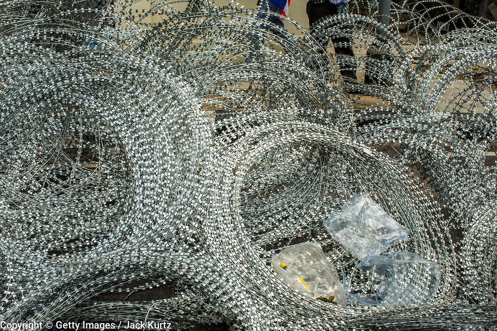 24 NOVEMBER 2012 - BANGKOK, THAILAND:  Coiled razor wire ready to be deployed during a large anti government, pro-monarchy, protest  on November 24, 2012 in Bangkok, Thailand. The Siam Pitak group, which sponsored the protest, cited alleged government corruption and anti-monarchist elements within the ruling party as grounds for the protest. Police used tear gas and baton charges againt protesters.       PHOTO BY JACK KURTZ