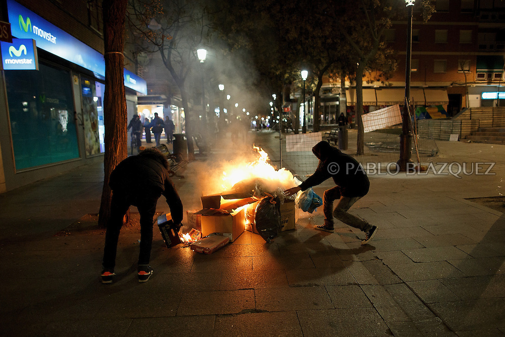 People make a burning barricade during clashes with police after a demonstration on the 12th day of public garbage collectors strike on February 1, 2014 in Alcorcon, near Madrid, Spain. Unions of rubbish collection public company ESMASA in Alcorcon called for demonstration on the 12th day of strike that ended peacefully outside City Hall. Alcorcon Mayor David Perez from the Popular Party (PP) plans to transfer some services that belong public garbage collectors to a private company.