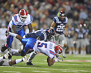 Louisiana Tech's Lennon Creer (5) is tackled by Ole Miss' Serderius Bryant (14) in Oxford, Miss. on Saturday, November 12, 2011.