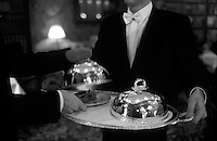 waiters at Restaurant Alain Ducasse, Paris - Photograph by Owen Franken