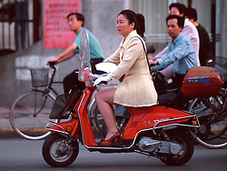 CHINA BEIJING APR99 - A woman rides a light motorcycle in downtown Beijing. ..jre/Photo by Jiri Rezac..© Jiri Rezac 1999..Contact: +44 (0) 7050 110 417.Mobile:  +44 (0) 7801 337 683.Office:  +44 (0) 20 8968 9635..Email:   jiri@jirirezac.com.Web:    www.jirirezac.com..© All images Jiri Rezac 1999 - All rights reserved.