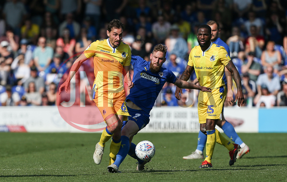 Ed Upson of Bristol Rovers and Scott Wagstaff of AFC Wimbledon tussle for the ball - Mandatory by-line: Arron Gent/JMP - 19/04/2019 - FOOTBALL - Cherry Red Records Stadium - Kingston upon Thames, England - AFC Wimbledon v Bristol Rovers - Sky Bet League One