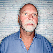 Rockville, Md., Oct. 1, 2007 - J. Craig Venter, PhD, in front of the Human Genome Sequence he mapped in 2001.