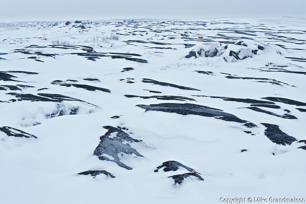 The frozen rocky shoreline of Hudson Bay<br /> Churchill<br /> Manitoba<br /> Canada