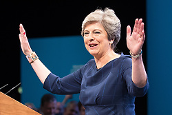 © Licensed to London News Pictures . 04/10/2017. Manchester, UK. Prime Minister THERESA MAY waves as she comes on stage and delivers her keynote speech on the fourth and final day of the Conservative Party Conference at the Manchester Central Convention Centre . Photo credit: Joel Goodman/LNP