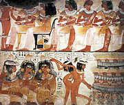 An entire wall of the tomb-chapel showed a feast in honour of Nebamun.  Naked serving girls and servants wait on his friends and relatives.  Married guests sit in pairs on fine chairs while the young women turn and talk to each other.