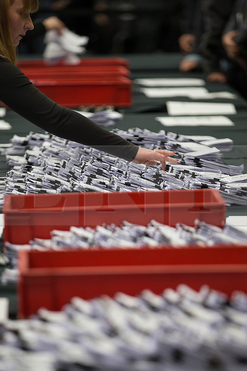 © Licensed to London News Pictures . 14/02/2014 . Manchester , UK . Ballots being counted and stacked . The count for the Wythenshawe and Sale East by-election , at Manchester Central this evening . Photo credit : Joel Goodman/LNP