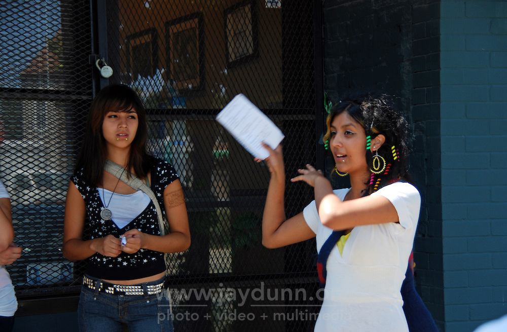 USA, Chicago, August 25, 2009.   Amairani Galvan, 15, listens to her older sister Viviana explain a polymer factory's influence on the neighborhood. The Little Village Environmental Justice Organization, headquartered in a predominantly Mexican-American neighborhood of Chicago, campaigns not only against pollution but for clean power, park facilities, urban agriculture, and restoring public transit. LVEJO's staff and volunteers make significant outreach and education efforts, especially for youth. Photo for an HOY feature story by Jay Dunn.