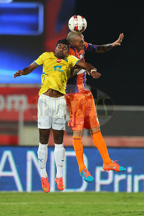 Bruno Cirillo of FC Pune City and CS Sabeeth of Kerala Blasters FC during match 17 of the Hero Indian Super League between FC Pune City<br /> and Kerala Blasters FC held at the Shree Shiv Chhatrapati Sports Complex Stadium, Pune, India on the 30th October 2014.<br /> <br /> Photo by:  Ron Gaunt/ ISL/ SPORTZPICS