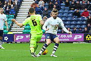 Huddersfield Midfielder Jonathon Hogg and Preston North End Midfielder Paul Gallagher battle during the Sky Bet Championship match between Preston North End and Huddersfield Town at Deepdale, Preston, England on 6 February 2016. Photo by Pete Burns.