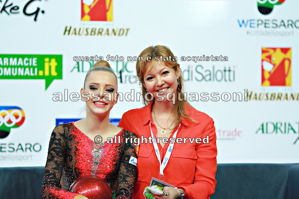 "Lyaysan Savitskaya, on right, is an honored Master of Sports coach of Russia in Rhythmic gymnastics. She born December 7, 1972 in Krasnodar,Russia. Polina Shmatko, on left, is a Russian individual rhythmic gymnast born on March 26, 2003 in Moscow, Russia. A double portrait on Kiss and Cry at ""Città di Pesaro"" 2016 international tournament."