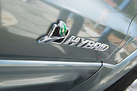 Close up of sing on hybrid car