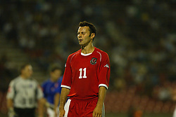 BELGRADE, SERBIA & MONTENEGRO - Wednesday, August 20, 2003: Wales' Ryan Giggs shows his dejected after his side's 1-0 defeat by Serbia & Montenegro during the UEFA European Championship qualifying match at the Red Star Stadium. (Pic by David Rawcliffe/Propaganda)