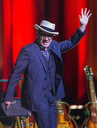 © Licensed to London News Pictures . 14/07/2014 .  Manchester , UK . ELVIS COSTELLO enters the stage for his show at the Bridgewater Hall this evening (Monday 14th July 2014) . Photo credit : Joel Goodman/LNP