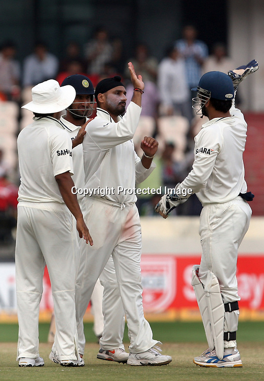 Indian bowler Harbhajan Singh celebrates with team mates  New Zealand batsman Kane Williamson wicket during the Indian vs New Zealand 2nd test match day-5 Played at Rajiv Gandhi International Stadium, Uppal, Hyderabad 16 November 2010 (5-day match)