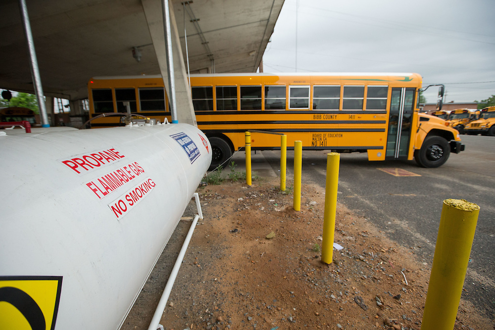 A propane-powered bus is refueled at the Bibb County Board of Education Transportation Department, where buses are maintained and refueled, photographed on Wednesday, April 15, 2015 in Macon, Ga. The green bird, Blue Bird's logo, signifieds that it is propane, where as a black logo means that it gasoline or diesel. Photo by Kevin Liles for The New York Times Photo by Kevin Liles for The New York Times