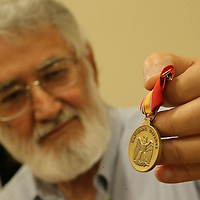 Kenneth Patterson holds his newly recieved National Defense Service Medal.