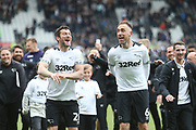 Derby County defender Richard Keogh (6) and Derby County forward David Nugent (28) celebrate reaching the play-offs during the EFL Sky Bet Championship match between Derby County and West Bromwich Albion at the Pride Park, Derby, England on 5 May 2019.