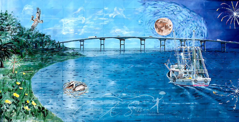 "An intricate mural of the Biloxi Bay Bridge graces a cinderblock wall May 8, 2011 at Camp Victor in Ocean Springs. Ocean Springs, known as the ""City of Discovery,"" features whimsical street art throughout the downtown area. Much of the artwork tells the story of the town's history, from its founding by the French in 1699 to the devastation and recovery after Hurricane Katrina. (Photo by Carmen K. Sisson/Cloudybright)"