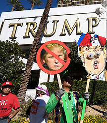Oct 19, 2016 - Las Vegas, Nevada, U.S. - Anti-Trump protesters rally in front of Trump International Hotel Wednesday as protesters built a wall of Taco Trucks outside the hotel. The third and final debate will be held Wednesday at Las Vegas Nevada University. (Credit Image: © Gene Blevins via ZUMA Wire)