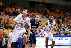 Greater Beckley Christian center Brent Daniels (21), Magnolia's Kyle Ritz (44) and Greater Beckley Christian guard Tyriek Walton (1) prepare for a rebound during a semi final round game at the Charleston Civic Center.