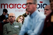 A potential supporter of Senator and 2016 Republican presidential candidate, Marco Rubio (R-FL), listens to him speak during a campaign event at Bev's on the River in Sioux City, IA on January 30, 2016. Rubio is in Iowa campaigning in the final days before the Iowa Caucus.<br />