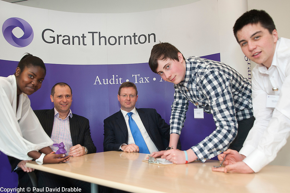 "Grant Thornton Business Awareness Day Chikumo Fiseko of Longley Park 6th form College (right) and Charlie Nixon with James Boreman of Silverdale School (right) make their pitch to The Grant Thornton ""Dragons"" Jamie Preston senior Tax Manager (seated left) and Paul Houghton Partner (seated right)..http://www.pauldaviddrabble.co.uk.4 April 2012 .Image © Paul David Drabble"