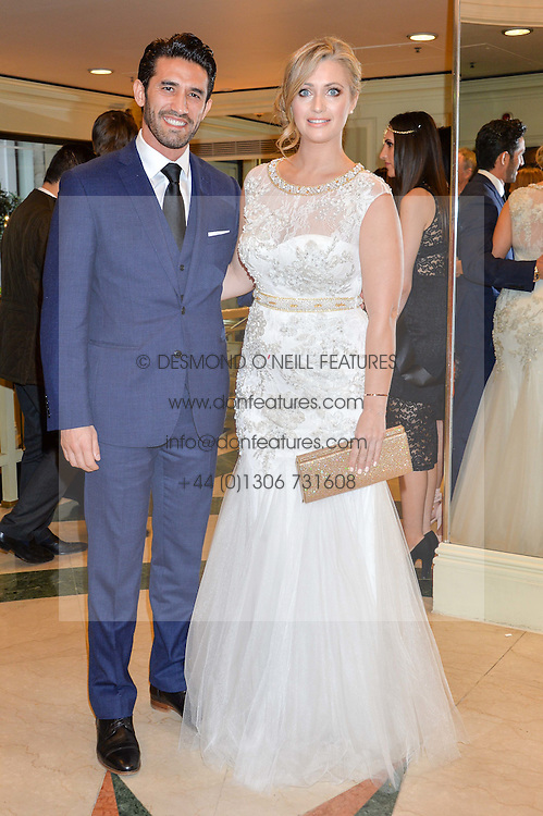 Sports presenter HAYLEY McQUEEN and KIRK NEWMANN at the 6th annual Asian Awards held at The Grosvenor House Hotel, Park Lane, London on 8th April 2016.