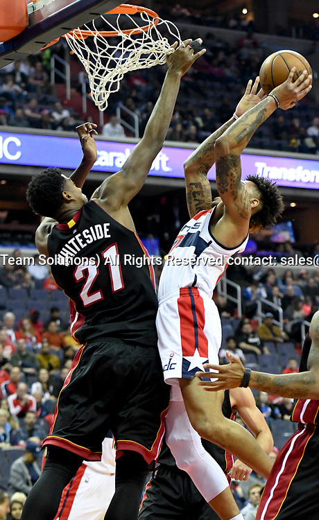 WASHINGTON, DC - APRIL 8: Washington Wizards forward Kelly Oubre Jr. (12) is fouled by Miami Heat center Hassan Whiteside (21) in the first half on April 8, 2017, at the Verizon Center in Washington, D.C.  The Miami Heat defeated the Washington Wizards 106-103.  (Photo by Icon Sportswire)