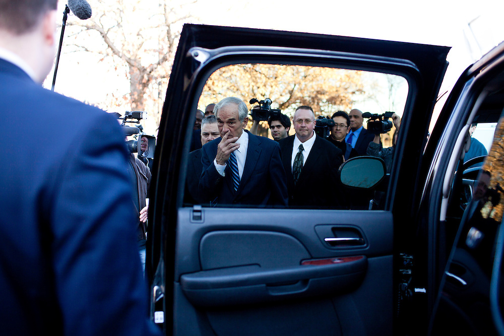 Republican presidential candidate Ron Paul leaves after speaking to employees of GuideOne Insurance on Wednesday, December 28, 2011 in West Des Moines, IA.