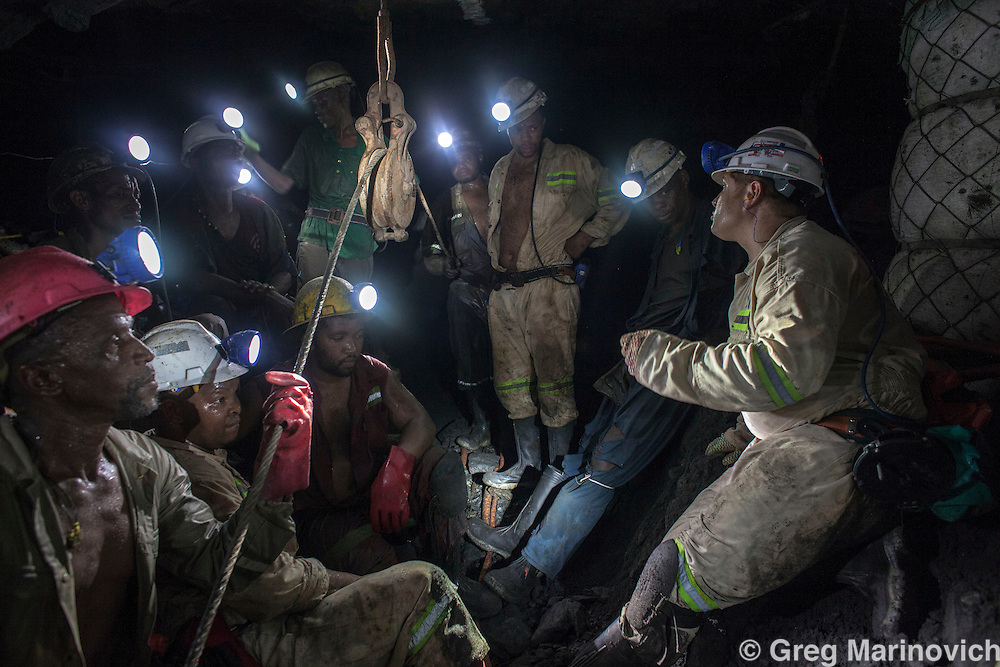 A team gathers to start the shift at 31 level, Rowland Shaft, Lonmin Mine, Marikana, North West Province. Photo Greg Marinovich