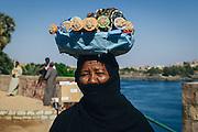Hajja Moza selling souvenir dolls in the nubian village