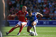 David Davis (26) is challenged by Ben Watson (8) during the EFL Sky Bet Championship match between Nottingham Forest and Birmingham City at the City Ground, Nottingham, England on 17 August 2019.