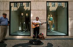 PORTUGAL LISBON MAY99 - A busker performs on the Rua Augusta in the Baixa district.....jre/Photo by Jiri Rezac....© Jiri Rezac 1999....Tel:   +44 (0) 7050 110 417..Email: info@jirirezac.com..Web:   www.jirirezac.com