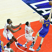 07 December 2016: Golden State Warriors guard Klay Thompson (11) goes for the layup past LA Clippers center DeAndre Jordan (6) and LA Clippers guard Austin Rivers (25) during the Golden State Warriors 115-98 victory over the Los Angeles Clippers, at the Staples Center, Los Angeles, California, USA.