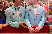 Joshua Smith, left, and Seth Stephens, right, both of Aiken, S.C. wait for Republican presidential candidate Donald Trump to speak at a campaign stop in Hilton Head Island, S.C., Wednesday, Dec. 30, 2015. (AP Photo/Stephen B. Morton)