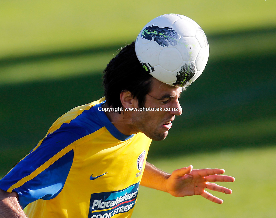 Central's Ivan Vicelich gets a head full of football. 2012 Chatham Cup, Third Round, Central United v Waitakere City FC, Kiwitea Street Auckland, Sunday 24th June 2012. Photo: Shane Wenzlick