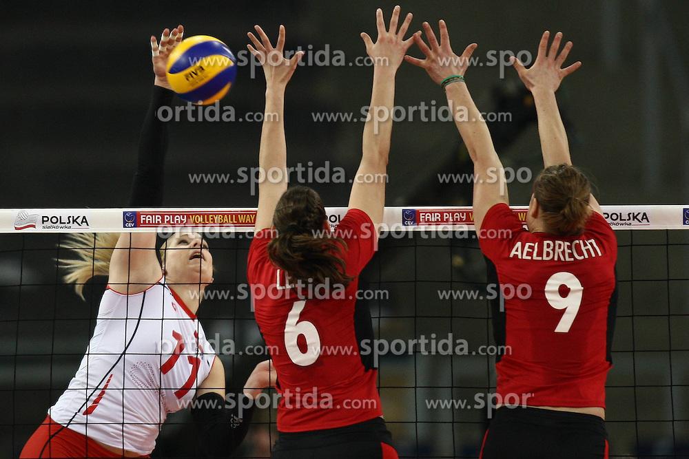 04.01.2014, Atlas Arena, Lotz, POL, FIVB, Damen WM Qualifikation, Belgien vs Schweiz, im Bild MANDY WIGGER (L) CHARLOTTE LEYS (C) FREYA AELBRECHT (P) // MANDY WIGGER (L) CHARLOTTE LEYS (C) FREYA AELBRECHT (P) during the ladies FIVB World Championship qualifying match between Belgium and Switzerland at the Atlas Arena in Lotz, Poland on 2014/01/05. EXPA Pictures &copy; 2014, PhotoCredit: EXPA/ Newspix/ Mateusz Trzuskowski<br /> <br /> *****ATTENTION - for AUT, SLO, CRO, SRB, BIH, MAZ, TUR, SUI, SWE only*****