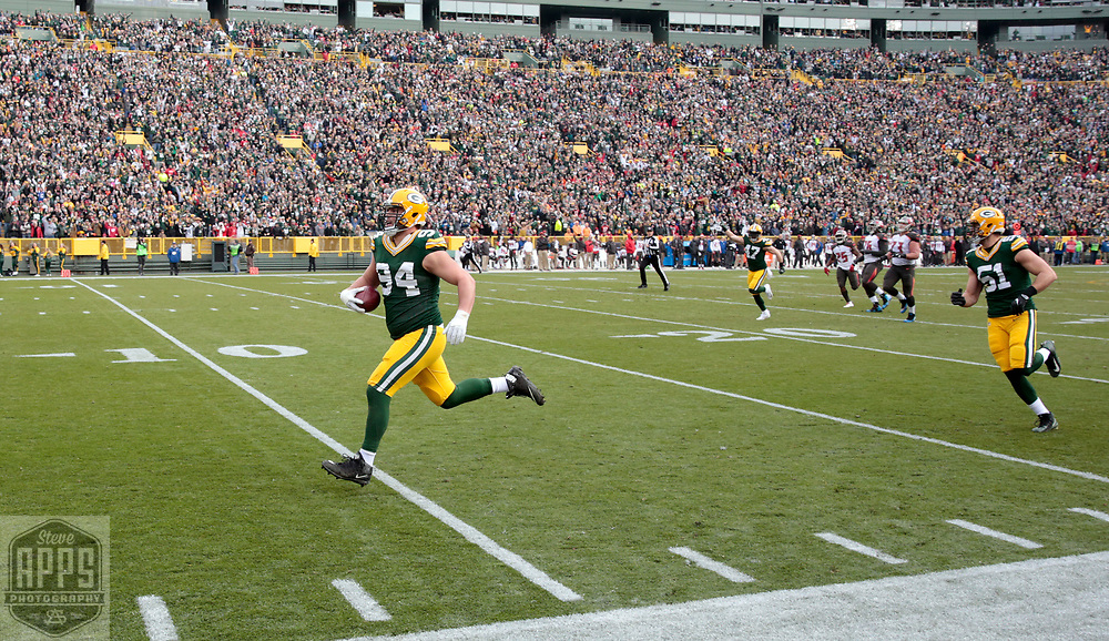 Green Bay Packers defensive end Dean Lowry (94) racing for a 62-yard touchdown after a fumble recovery in the 2nd quarter. <br /> The Green Bay Packers hosted the Tampa Bay Buccaneers at Lambeau Field in Green Bay,  Sunday, Dec. 3, 2017.  STEVE APPS FOR THE STATE JOURNAL.