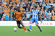 Dale Stephens attempts to tackle Sheyi Ojo during the Sky Bet Championship match between Wolverhampton Wanderers and Brighton and Hove Albion at Molineux, Wolverhampton, England on 19 September 2015. Photo by Alan Franklin.
