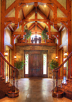 The entry way to a upscale home with rustic, but tasteful, wookwork and flooring