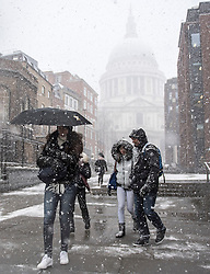 © Licensed to London News Pictures. 27/02/2018. London, UK. Members of the public wade through heavy snowfall in front of St Paul's Cathedral in the City of London, as a cold front, named the 'Beast From the East' hits the capital. Amber weather warnings are in place for large parts of the east of the UK as a severe cold front heads in from Russia. Photo credit: Ben Cawthra/LNP