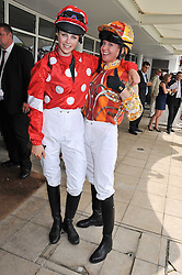 Left to right, EDIE CAMPBELL and KATE REARDON at the 3rd day of the 2011 Glorious Goodwood Racing Festival - Ladies Day at Goodwood Racecourse, West Sussex on 28th July 2011.