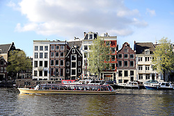 Amsterdam is the largest city and the capital of the Netherlands. Amsterdam has a population of 783,364 within city limits, an urban population of 1,209,419 and a metropolitan population of 2,158,592. The city is in the province of North Holland in the west of the country. It comprises the northern part of the Randstad, one of the larger conurbations in Europe, with a population of approximately 7 million..Its name is derived from Amstelredamme,[9] indicative of the city's origin: a dam in the river Amstel. Settled as a small fishing village in the late 12th century, Amsterdam became one of the most important ports in the world during the Dutch Golden Age, a result of its innovative developments in trade. During that time, the city was the leading center for finance and diamonds.<br /> <br /> In the 19th and 20th centuries, the city expanded, and many new neighborhoods and suburbs were formed. The 17th-century canals of Amsterdam, located in the heart of Amsterdam, were added to the UNESCO World Heritage List in July 2010.