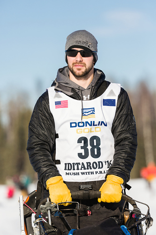 Musher Richie Diehl competing in the 44th Iditarod Trail Sled Dog Race on Long Lake after leaving the restart on Willow Lake in Southcentral Alaska.  Afternoon. Winter.