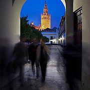 Giralda tower from an arch in the old juderia, Seville
