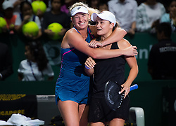 October 26, 2018 - Kallang, SINGAPORE - Coco Vandeweghe of the United States & Ashleigh Barty of Australia celebrate winning their doubles quarterfinal at the 2018 WTA Finals tennis tournament (Credit Image: © AFP7 via ZUMA Wire)