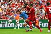 Manchester City midfielder Bernardo Silva (20) under pressure from Liverpool striker Roberto Firmino (9) and Liverpool striker Divock Origi (27) during the FA Community Shield match between Manchester City and Liverpool at Wembley Stadium, London, England on 4 August 2019.